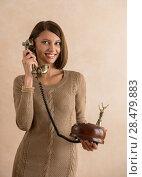 Купить «Happy elegant woman talking on retro telephone», фото № 28479883, снято 18 января 2014 г. (c) Ingram Publishing / Фотобанк Лори