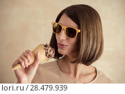 Купить «Ice cream woman singing in cone like in microphone happy, joyful and cheerful. Cute young female model eating ice cream cone», фото № 28479939, снято 18 января 2014 г. (c) Ingram Publishing / Фотобанк Лори