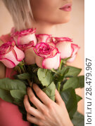 Купить «Unrecognizable woman holding bouquet of pink roses. She is very satisfacted. Valentine's day or international women's day celebration.», фото № 28479967, снято 18 января 2014 г. (c) Ingram Publishing / Фотобанк Лори