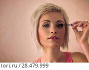 Купить «Elegant blonde beauty doing makeup», фото № 28479999, снято 18 января 2014 г. (c) Ingram Publishing / Фотобанк Лори