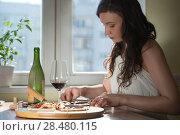 Купить «Beautiful young woman eating homemade pizza and drinking red wine at home», фото № 28480115, снято 3 мая 2014 г. (c) Ingram Publishing / Фотобанк Лори