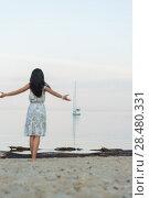 Купить «Free woman enjoying freedom feeling happy at beach at morning. Beautiful serene woman and welcoming yacht and sailor with arms opened outstretched up. Hispanic Caucasian female model», фото № 28480331, снято 22 июня 2014 г. (c) Ingram Publishing / Фотобанк Лори