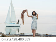 Купить «Free woman enjoying freedom feeling happy at beach at morning. Beautiful serene woman and welcoming yacht and sailor with arms opened outstretched up. Hispanic Caucasian female model», фото № 28480339, снято 22 июня 2014 г. (c) Ingram Publishing / Фотобанк Лори