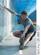 Купить «Attractive fit young man stretching before exercise, sunrise early morning backlit. Shallow depth of field», фото № 28480527, снято 22 июня 2014 г. (c) Ingram Publishing / Фотобанк Лори