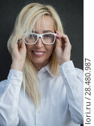 Купить «Mature business woman wearing glasses», фото № 28480987, снято 20 июля 2014 г. (c) Ingram Publishing / Фотобанк Лори