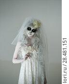 Купить «Halloween witch. Beautiful woman wearing santa muerte mask and wedding dress. Dead widow in grief», фото № 28481151, снято 21 сентября 2014 г. (c) Ingram Publishing / Фотобанк Лори