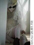 Купить «Halloween witch. Beautiful woman wearing santa muerte mask and wedding dress. Dead widow in grief», фото № 28481159, снято 21 сентября 2014 г. (c) Ingram Publishing / Фотобанк Лори