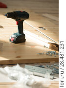 Купить «Battery screwdriver on wooden floor in new unfurnished home», фото № 28481231, снято 10 октября 2014 г. (c) Ingram Publishing / Фотобанк Лори