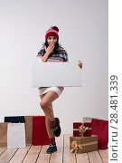 Купить «Christmas woman hold big white card copyspace. Winter knitted beanie hat. Full length.», фото № 28481339, снято 15 октября 2014 г. (c) Ingram Publishing / Фотобанк Лори