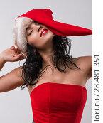 Купить «Portrait of beautiful sexy girl wearing santa claus clothes», фото № 28481351, снято 15 октября 2014 г. (c) Ingram Publishing / Фотобанк Лори