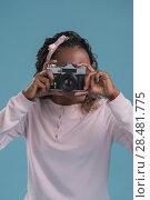 Купить «Beautiful young african woman using camera and photographing on blue background», фото № 28481775, снято 19 ноября 2014 г. (c) Ingram Publishing / Фотобанк Лори