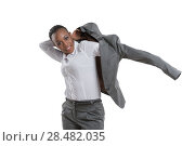 Купить «African business woman putting on jacket isolated on white background», фото № 28482035, снято 20 ноября 2014 г. (c) Ingram Publishing / Фотобанк Лори