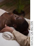 Купить «Portrait of young beautiful african woman in spa environment getting massage», фото № 28482335, снято 19 ноября 2014 г. (c) Ingram Publishing / Фотобанк Лори