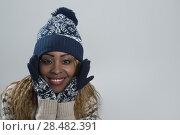 Купить «Portrait of african woman on gray background wearing woolen accessories», фото № 28482391, снято 20 ноября 2014 г. (c) Ingram Publishing / Фотобанк Лори