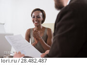 Купить «Image of two young businesspeople of diverse ethnicity businessman and businesswoman at meeting», фото № 28482487, снято 20 ноября 2014 г. (c) Ingram Publishing / Фотобанк Лори