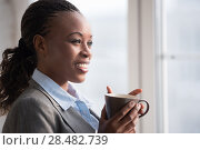 Купить «Candid image of a businesswoman drinking coffee while working at office. Selective focus.», фото № 28482739, снято 1 декабря 2014 г. (c) Ingram Publishing / Фотобанк Лори
