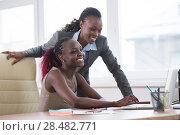 Купить «Young african business women in office working together on laptop», фото № 28482771, снято 1 декабря 2014 г. (c) Ingram Publishing / Фотобанк Лори