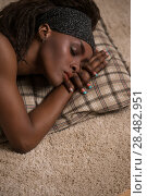 Купить «Young african woman sleeping at home on carpet with pillow», фото № 28482951, снято 1 декабря 2014 г. (c) Ingram Publishing / Фотобанк Лори