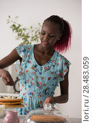Купить «Young Woman Cooking at home. Healthy Food. Dessert Concept. Healthy Lifestyle. Cooking At Home. Prepare Food», фото № 28483059, снято 1 декабря 2014 г. (c) Ingram Publishing / Фотобанк Лори