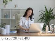 Купить «Doctor working with laptop computer at her office», фото № 28483403, снято 6 июня 2015 г. (c) Ingram Publishing / Фотобанк Лори