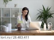 Купить «Doctor analyzing medical test results of her patient at her office», фото № 28483411, снято 6 июня 2015 г. (c) Ingram Publishing / Фотобанк Лори