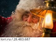 Купить «Santa Clause walking outdoors under falling snow with vintage lamp», фото № 28483687, снято 25 сентября 2013 г. (c) Ingram Publishing / Фотобанк Лори