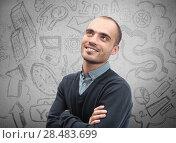 Купить «Young business man thinking of his plans closeup face portrait and sketches overhead», фото № 28483699, снято 20 октября 2018 г. (c) Ingram Publishing / Фотобанк Лори