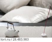 Купить «Teapot and incense stick on table at comfortable relaxation lounge», фото № 28483983, снято 19 декабря 2012 г. (c) Ingram Publishing / Фотобанк Лори