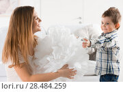 Купить «Joyful toddler playing with paper home decoration and his mother», фото № 28484259, снято 31 марта 2013 г. (c) Ingram Publishing / Фотобанк Лори
