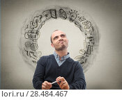 Thinking businessman, sketch with business icons on the background. Стоковое фото, фотограф Kirill Kedrinskiy / Ingram Publishing / Фотобанк Лори