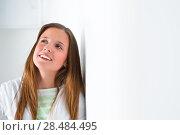 Купить «Portrait of a beautiful college student at campus daydreaming», фото № 28484495, снято 13 апреля 2013 г. (c) Ingram Publishing / Фотобанк Лори