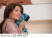 Купить «Shopping Girl Portrait. Beautiful Woman with Sweater in Clothes Store. Shopper. Sales. Shopping Center», фото № 28484627, снято 22 сентября 2013 г. (c) Ingram Publishing / Фотобанк Лори
