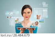 Купить «Young pretty woman using social media on her tablet computer», фото № 28484679, снято 17 ноября 2012 г. (c) Ingram Publishing / Фотобанк Лори