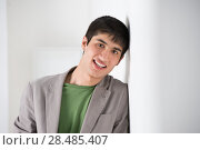 Купить «Mixed ethnicity handsome man leaning on white wall with editable copyspace», фото № 28485407, снято 13 апреля 2013 г. (c) Ingram Publishing / Фотобанк Лори
