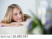 Купить «Woman on spa or massage with flowers and cosmetics on foreground making perfect copyspace», фото № 28485587, снято 7 мая 2013 г. (c) Ingram Publishing / Фотобанк Лори