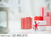 Купить «Gift boxes with xmas presents wrapped in red paper with ornament. Lots of copyspace», фото № 28485815, снято 2 ноября 2012 г. (c) Ingram Publishing / Фотобанк Лори