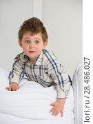 Купить «Cute little boy playing at home on sofa», фото № 28486027, снято 31 марта 2013 г. (c) Ingram Publishing / Фотобанк Лори