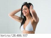 Купить «Woman washing her head while showering with happy smile and water splashing. Beautiful Caucasian female model home in shower cabin.», фото № 28486107, снято 7 мая 2013 г. (c) Ingram Publishing / Фотобанк Лори