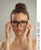 Купить «Portrait of hot sexy naked woman wearing glasses», фото № 28486259, снято 22 сентября 2013 г. (c) Ingram Publishing / Фотобанк Лори
