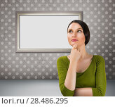 Купить «Beautiful young woman daydreaming over gray retro grunge background with blank picture frame», фото № 28486295, снято 13 декабря 2019 г. (c) Ingram Publishing / Фотобанк Лори