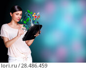Купить «Poster portrait of young beautiful woman holding her universal device - tablet pc. Lots of things are appearing from the display. Universality of modern devices concept», фото № 28486459, снято 30 октября 2011 г. (c) Ingram Publishing / Фотобанк Лори