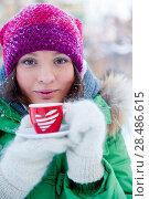 Купить «Young woman in winter outfit enjoy a coffee», фото № 28486615, снято 2 января 2012 г. (c) Ingram Publishing / Фотобанк Лори