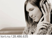 Купить «Young girl listening to the music with headphone. Relax», фото № 28486635, снято 25 февраля 2011 г. (c) Ingram Publishing / Фотобанк Лори