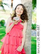 Купить «Portrait of pretty happy female model eating exotic Asian Dragon Fruit», фото № 28486687, снято 26 февраля 2012 г. (c) Ingram Publishing / Фотобанк Лори