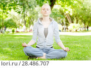 Купить «Blonde woman practise yoga and meditatation at the park», фото № 28486707, снято 26 июля 2011 г. (c) Ingram Publishing / Фотобанк Лори