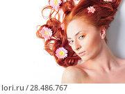 Купить «Red haired model with ornamental flower on isolated background», фото № 28486767, снято 15 апреля 2011 г. (c) Ingram Publishing / Фотобанк Лори