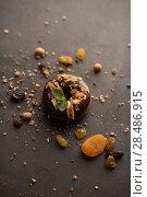 Купить «Chocolate Donut with mint leaf on dark stone background», фото № 28486915, снято 12 февраля 2015 г. (c) Ingram Publishing / Фотобанк Лори
