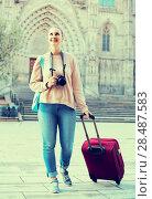 Купить «young woman holding camera in hands and photographing in city», фото № 28487583, снято 4 мая 2017 г. (c) Яков Филимонов / Фотобанк Лори