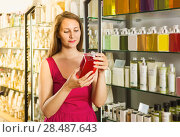 Купить «woman take a choise fresh liquid soap in perfume supermarket», фото № 28487643, снято 2 мая 2017 г. (c) Яков Филимонов / Фотобанк Лори