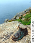 Купить «Boot of pilgrim (Cape Fisterra, Galicia, Spain).», фото № 28489251, снято 14 мая 2016 г. (c) Юрий Брыкайло / Фотобанк Лори